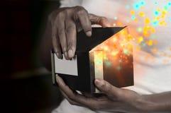 Magic gift box. Woman opening a magic gift box royalty free stock photo