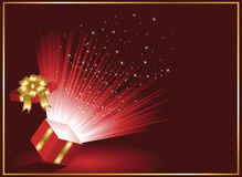 Magic Gift box on red background Stock Photos