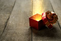 Magic gift box. On wooden desk Royalty Free Stock Image