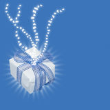 Magic gift with light rays and heart trails Royalty Free Stock Images