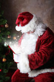 Magic Gift for Santa. Gift overflowing with magical sparkles and glow for santa stock image