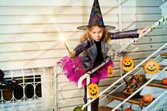 Magic girl. Beautiful little girl in a costume of witch celebrating halloween. Trick or treat. Halloween party stock images