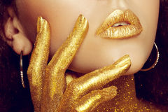 Magic Girl Portrait in Gold. Golden Makeup stock photography