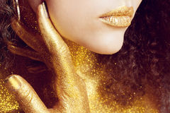 Magic Girl Portrait in Gold. Golden Makeup Stock Images