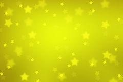 Magic gold colored blurred star shape Xmas background Royalty Free Stock Images