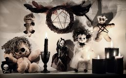 Burning black candles, weird voodoo dolls and pentagram royalty free stock photo