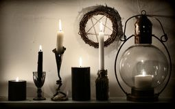 Vintage lamp, weird candles and pentagram on the wall royalty free stock photos