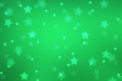 Magic green colored blurred star shape Xmas background Royalty Free Stock Images