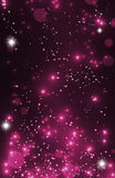 Magic Happy Holidays lights sparkling pixie dust background with. Purple pink love fairy tale postcard concept. Defocused dark bokeh lights wallpaper. Valentine' Royalty Free Stock Photos