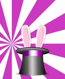 Magic hat with bunny ears on pink and white sunburst background. Magic hat with bunny ears on vibrant colorful pink and white sunburst rays pattern background Stock Photo