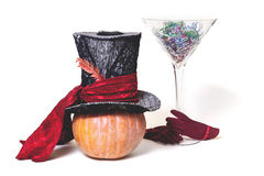 Magic hat and  huge glass of pumpkin Royalty Free Stock Photography