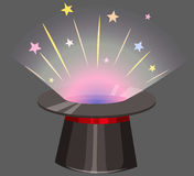 Magic hat with light beam coming out Stock Images
