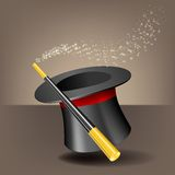 Magic hat and wand with sparkles. Royalty Free Stock Photo