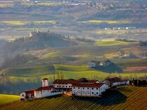 The magic hill Langhe Piedmont Italy Europe. Vineyards and green fields Langhe Piedmont Italy Europe Stock Images