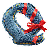 Magic holiday jeans alphabet letter with red ribbon Stock Photos