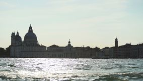 Magic hour in Venice, vaporetto sailing along Grand Canal, tourist attractions. Stock footage stock video