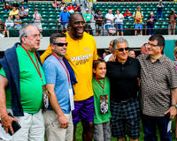 Magic Johnson poses with fans. Royalty Free Stock Photo