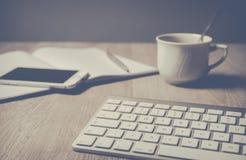 Magic Keyboard Beside Coffee Mug on Desk Stock Images