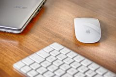 Magic Keyboard, Magic Mouse of Apple iMac and Laptop Acer royalty free stock images