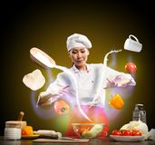 Magic in the kitchen. Magician chef cook in the kitchen, preparing with magic Stock Images