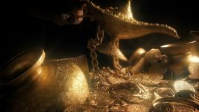 Magic Lamp Picked Up From Treasure Pile. Magic lamp is taken from pile of sparkling gold treasure stock footage