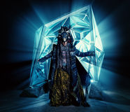 Magic legend. Portrait of a male shaman in ethnic dress on a background of a futuristic exterior. Fantasy concept, magic Royalty Free Stock Photo