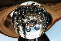 Magic Light. Crystal ball on dark background stock image