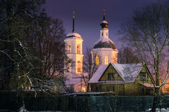 Magic light. Pouring from the windows of the Church on the eve of Christmas Royalty Free Stock Images