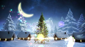 Magic light swirling around and decorating christmas tree stock video