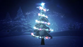Magic light swirling around snowy christmas tree stock video