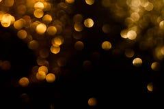 Magic lights christmas bokeh on black background stock photo