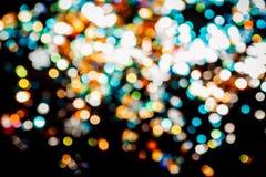 Magic lights christmas bokeh on black background stock photos