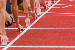 Magic line. Hands gather around start line for race Royalty Free Stock Images