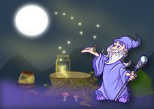 The magic of Mago Merlino. Magician Merlin who frees the fireflies with the help of a fairy Royalty Free Stock Photography