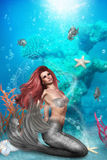 Magic Mermaid. A magic mermaid sits on the seabed and looks longingly at the sea level - silver fish  swim around them Stock Photo