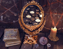 Magic mirror with Tarot cards and burning candles Stock Photo