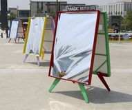 Magic mirrors in a bright frame. Entertainment for children and adults stock images