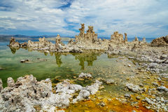 Magic of Mono Lake. Outliers - bizarre calcareous tufa formation on the smooth water of the lake. Stock Photo