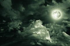 Magic moon over the clouds. Magic moon in the night sky Stock Photos
