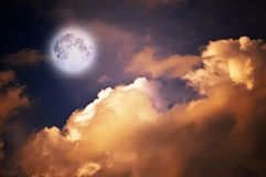 Magic moon over the clouds. Magic moon in the night sky Royalty Free Stock Photography