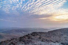 Magic morning orange sunrise dawn over holy land judean desert in Israel. Landscape with beautiful red sun and blue clouds. Road to infinite violet land Royalty Free Stock Photography