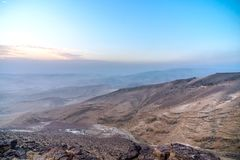 Magic morning sunrise and beautiful sunlight over judean negev desert in Israel. Middle east holy land nature with colorful orange pink sun rays, mountains and Royalty Free Stock Photos