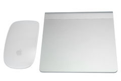 Magic mouse and magic trackpad isolated on white background. BANGKOK - NOVEMBER 26: Magic Mouse and Magic Trackpad are very useful computer input accessories for Royalty Free Stock Image