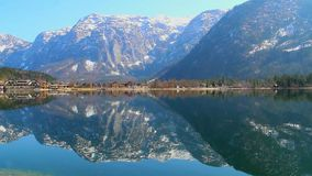 Magic nature, mountains reflection in water, picturesque village. Stock footage stock footage