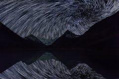 Magic night landscape with mountains, frozen lake Stock Photo