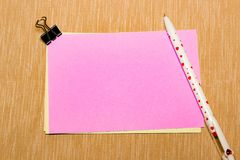 Magic pen and paper note and paperclip on yellow background, minimal concept and similarities differences.  Stock Images