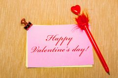Magic pen and paper note and paperclip on yellow background, minimal concept and similarities differences. Happy Valentine s day. Magic pen and paper note and Royalty Free Stock Photo