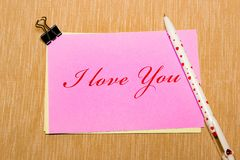Magic pen and paper note and paperclip on yellow background, minimal concept and similarities differences. I love you. Magic pen and paper note and paperclip on Royalty Free Stock Images