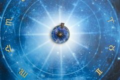 Magic pendant on blue horoscope like astrology, zodiac. esoteric topic. Sun astrology with zodiac signs, rays of light and starry horoscope stock photos