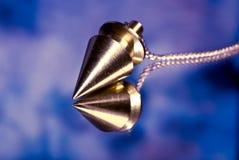 Magic pendulum stock images